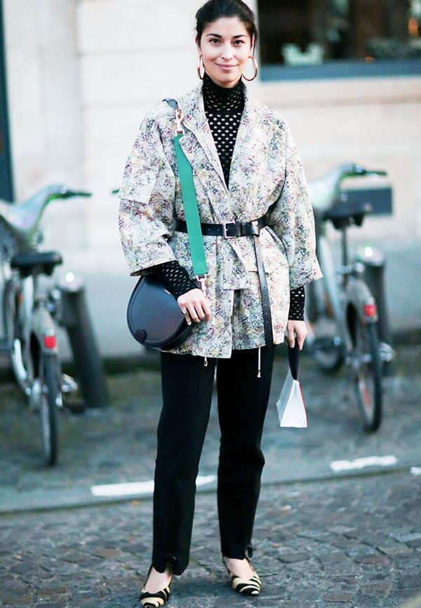 Style Notes: Caroline Issa ties a skinny belt over a floral blazer.