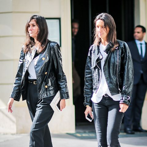 what to wear with black jeans: Geraldine Saglio wearing black jeans with a biker jacket and ladylike shoes