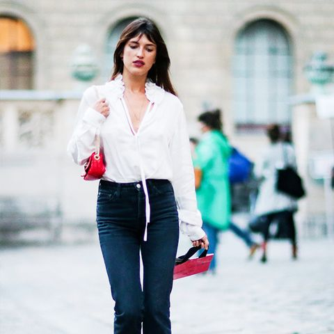 what to wear with black jeans: Jeanne Damas wearing black flares and a white blouse