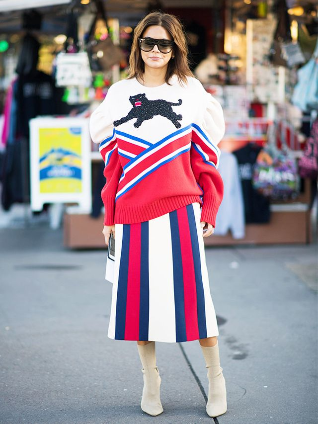 Christine Centenera went for red, white, and blue striped top to bottom, pairing her varsity sweater with a coordinating skirt.
