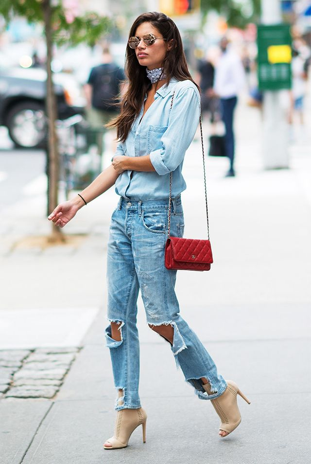 Sara Sampaio lightens it up with an airy button-down and faded ripped jeans she accessorizes with a white bandanna worn as a choker. Her relaxed look is elevated by tan booties. Have a...