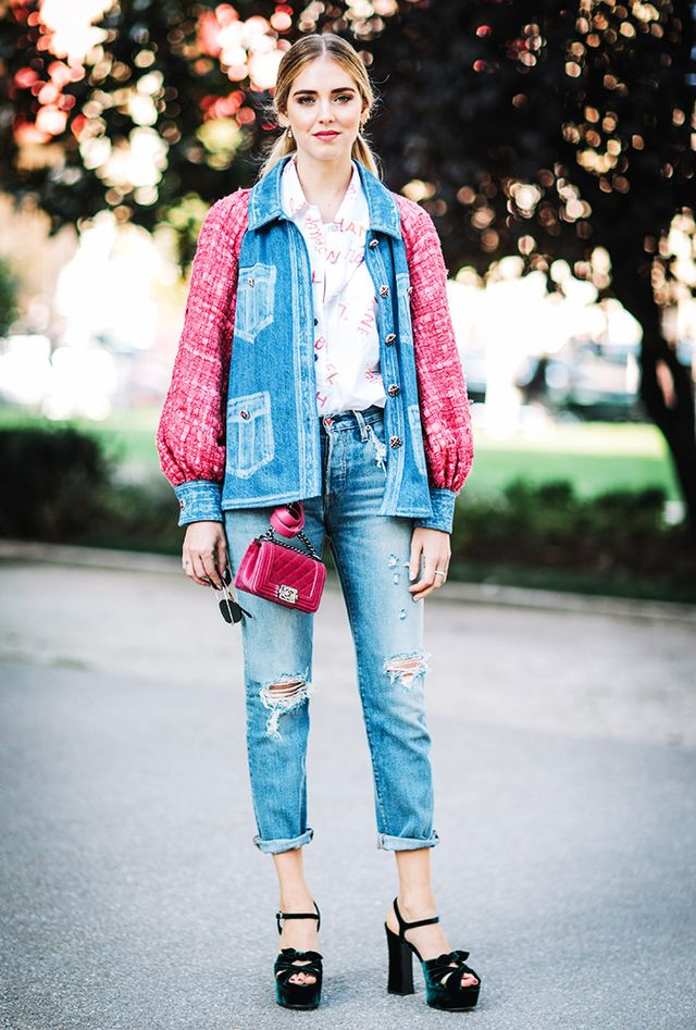 Chiara Ferragni dons a playful pouf-sleeved rendition of the denim-on-denim look with classic Levi's 501 stretch dark jeans ($315), replete with girly additions like a miniature Chanel Boy...