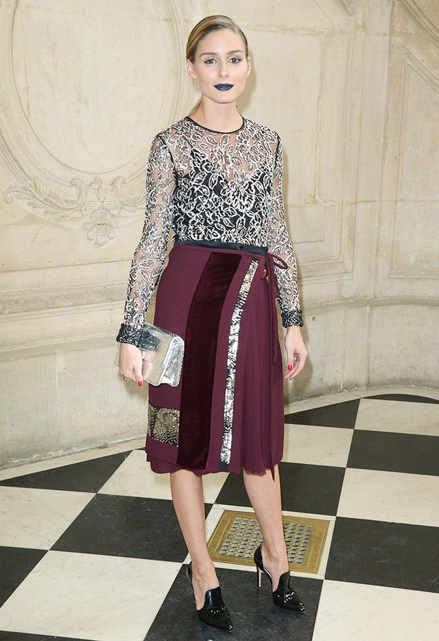 Olivia Palermo gives vampy gusto to the classic pairing with metallic lace mirrored with a metallic clutch and wrap skirt with matching detailing.