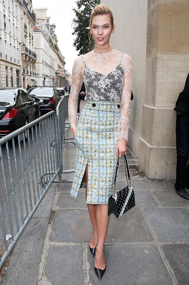 Karlie Kloss is every bit a lady in white lace and a fitted skirt bearing an artsy take on window check.