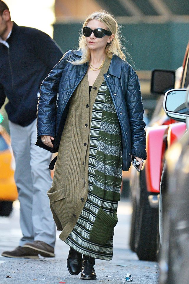 On Ashley Olsen: Maison Margiela Long Patchwork Cardigan ($2490); The Row boots. Ashley covered up for fall, wearing a long cardigan with ankle boots and a quilted jacket.