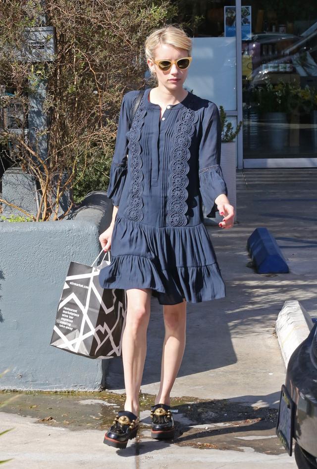 On Emma Roberts:Garret Leight x Clare V Sable Sunglasses ($340),Loft Lacy Flounce Dress ($98),Coach Turnlock Creeper Slides ($345).