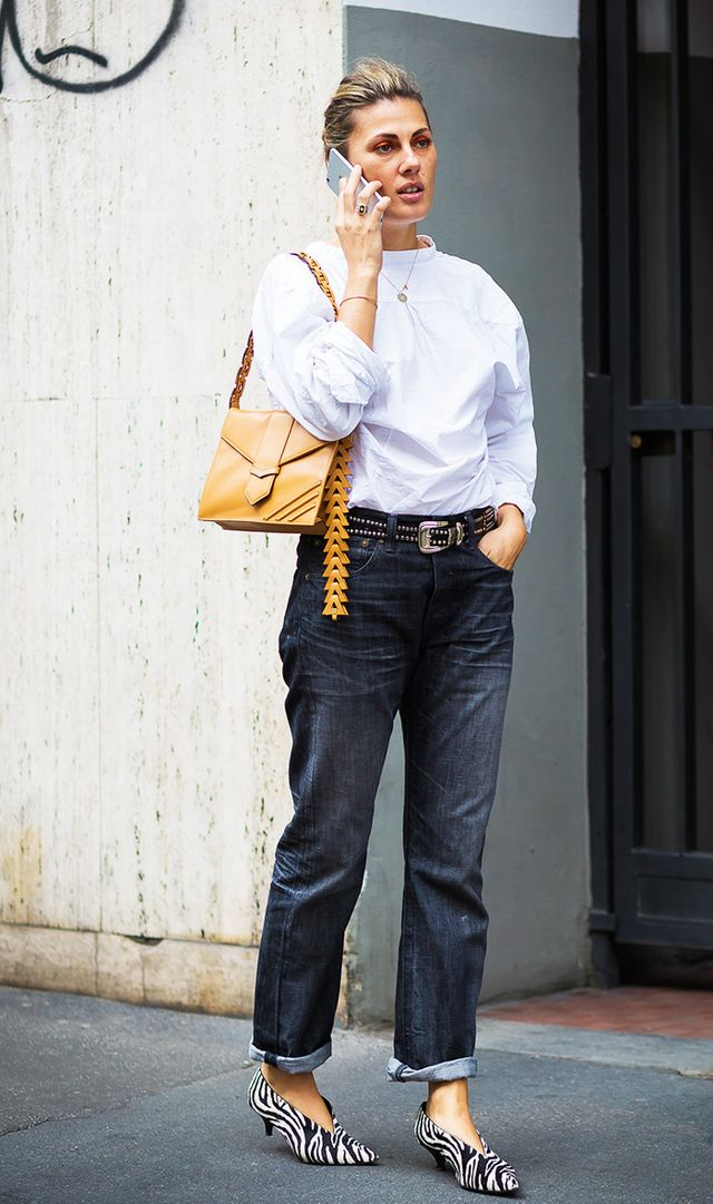 3. Style your cuffed jeans with stand-out accessories and a polished top for a cool contrast.