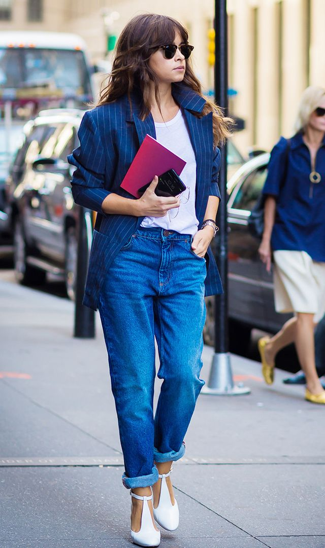 4. Make a pair of baggy jeans more flattering by cuffing them just high enough to show your ankles.