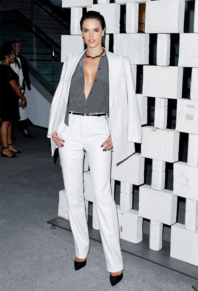 WHO: Alessandra Ambrosio WEAR: Bottega Veneta white blazer, pants, and blouse.