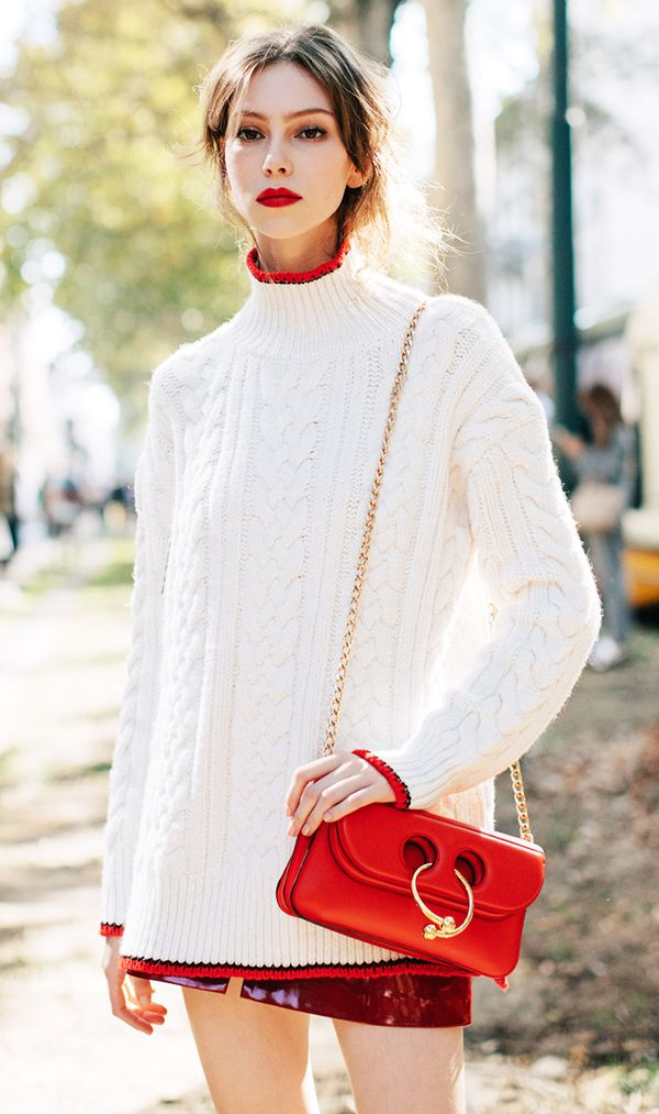 We love the subtle pop of red on her turtleneck—mixes perfectly with her J.W. Anderson bag.