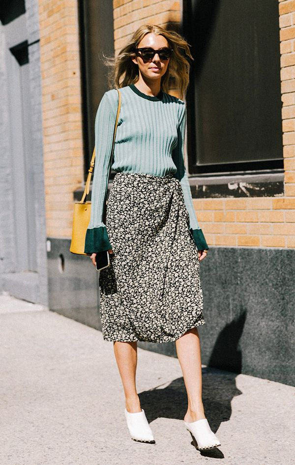 Sweater, midi skirt, and white shoes at fashion week.