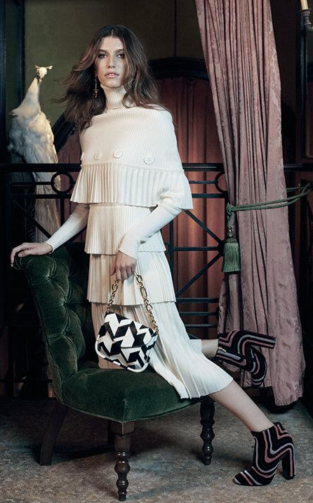 Salvatore Ferragamo Tiered Dress ($2390), Small Flap Bag ($2250), and Zig Zag Booties ($1890)