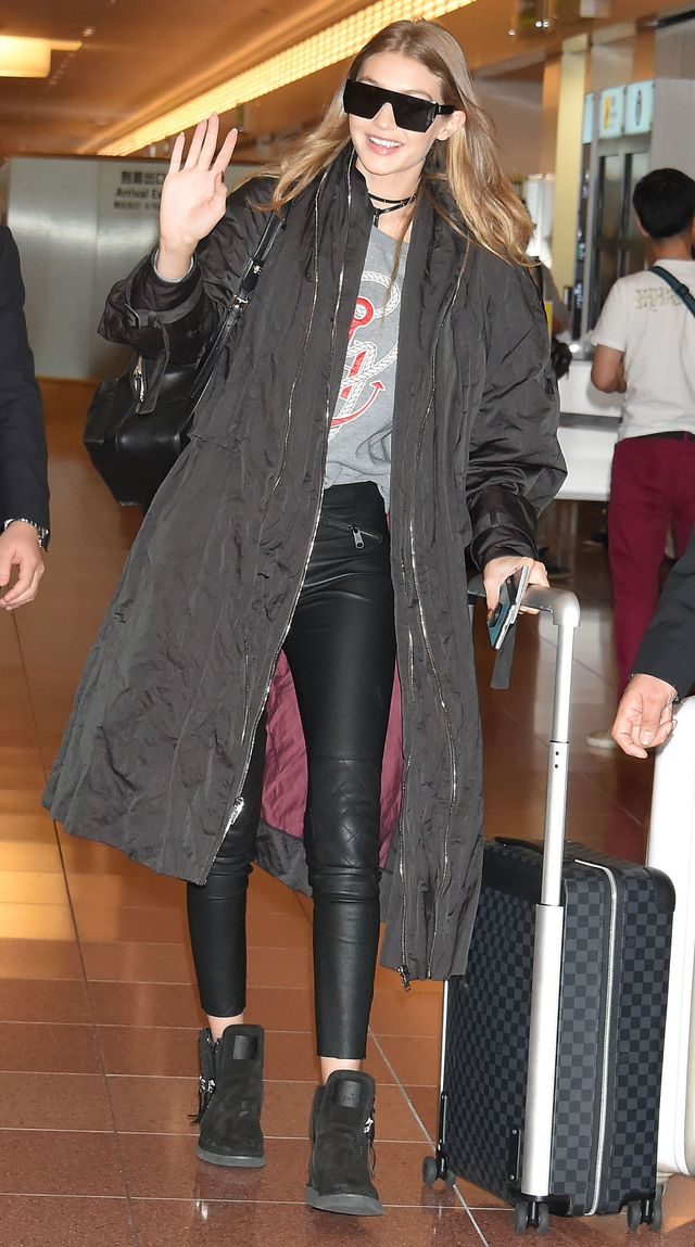 On Gigi Hadid:Tommy Hilfiger Gigi Sweatshirt($95);Versace Medusa Backpack($1895); Giuseppe Zanotti Zayn Zigi Black Suede Ankle Boots.