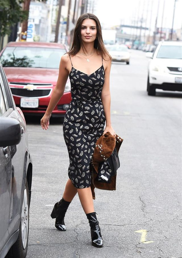 On Emily Ratajkowski: Harley Viera Newton dress; A.L.C. Blaine Studded Suede Jacket ($873); Gianvito Rossi Patent Leather Rolling High Booties ($995); Céline handbag.