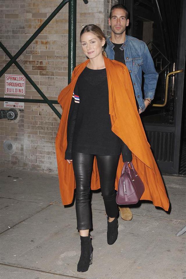 On Olivia Palermo: Zara coat, P.E. Nation Reverse Camber Mesh Knit($220), J. Brand 8001 Leather Skinny Pants, ($1000), and Max & Co. handbag.