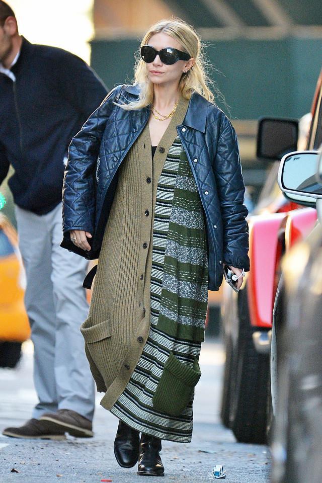 Ashley Olsen wearing a cardigan.