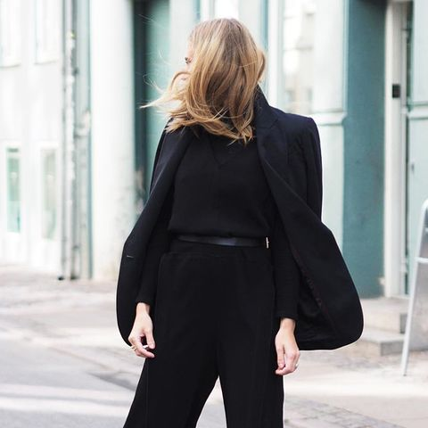 When wearing an all black outfit, the addition of colorful heels adds a nice touch.