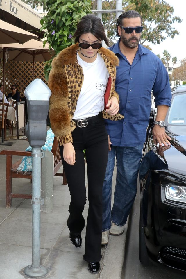 On Kendall Jenner: Gucci belt; Elizabeth and James sunglasses.