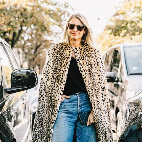 A leopard print cape and jeans.