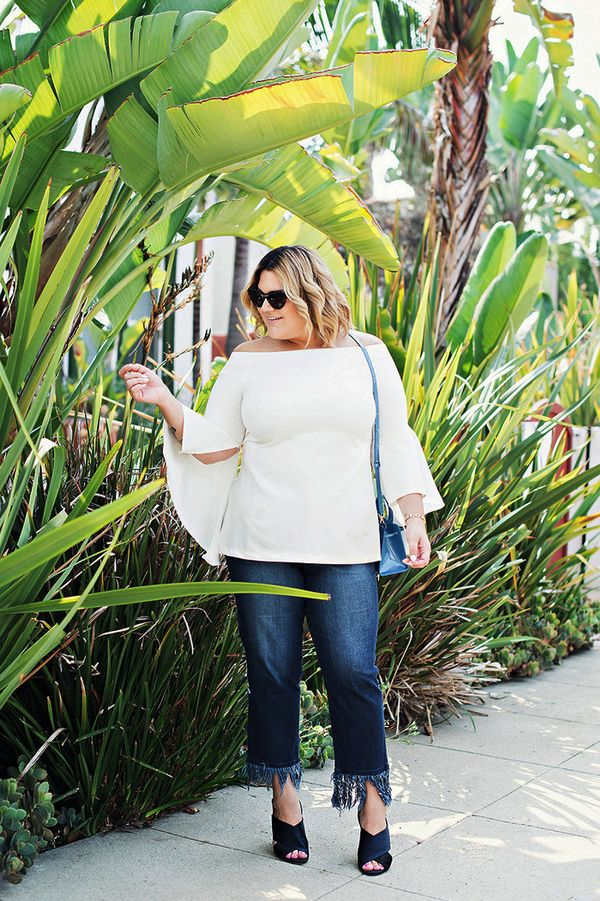 This outfit is ideal if you live somewhere warmer—a bell-sleeve blouse, fringed jeans, and a pair of gorgeous crisscross mules.