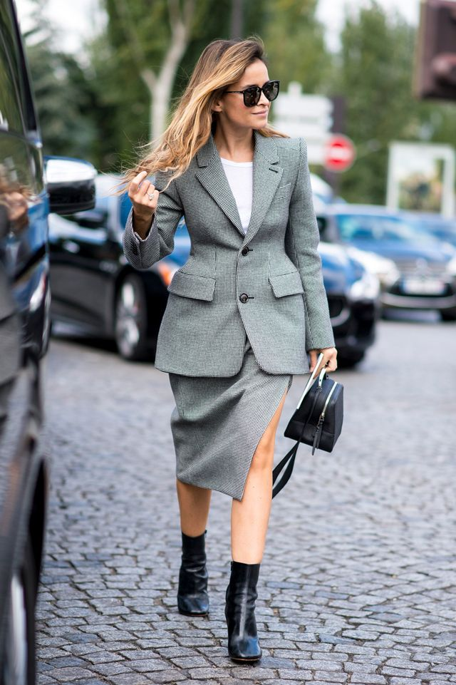Miroslava Duma wearing a Balenciaga houndstooth blazer, skirt, white T-shirt and black ankle boots.