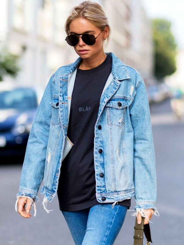 A denim jacket worn with a black T-shirt, and blue jeans.