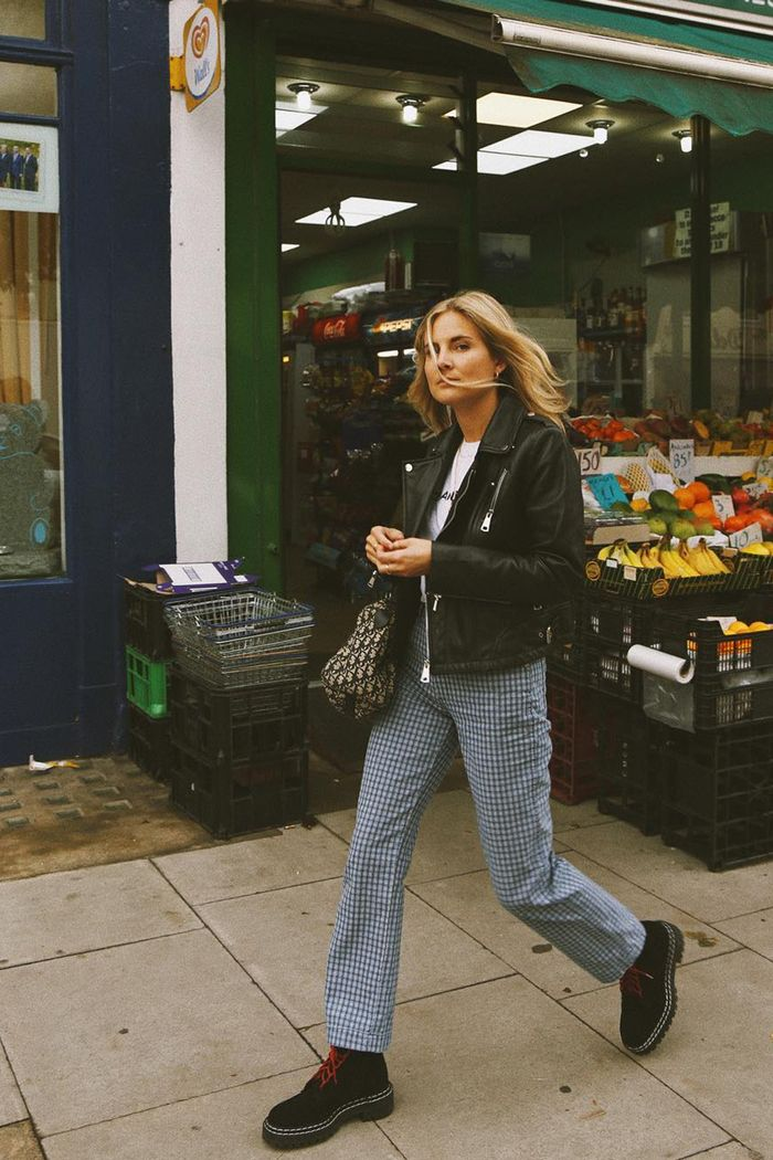 Best winter boots: Lucy Williams in checked trousers a biker jacket and chunky Proenza Schouler boots