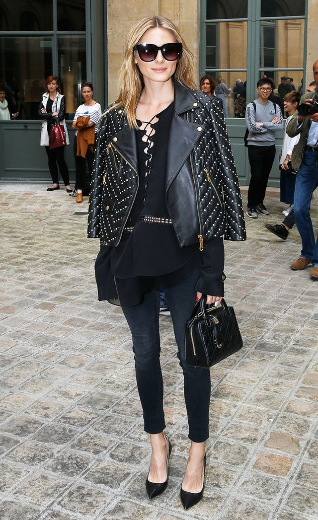 Olivia Palermo in embellished leather moto jacket with lace-up top and jeans