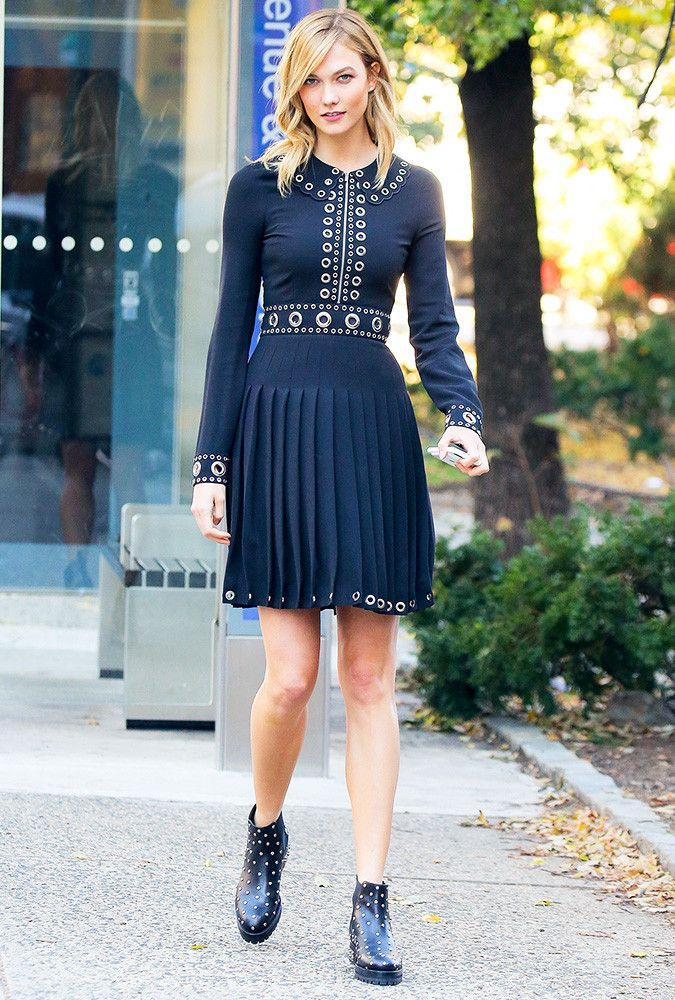 Karlie Kloss wearing a dress and ankle boots.