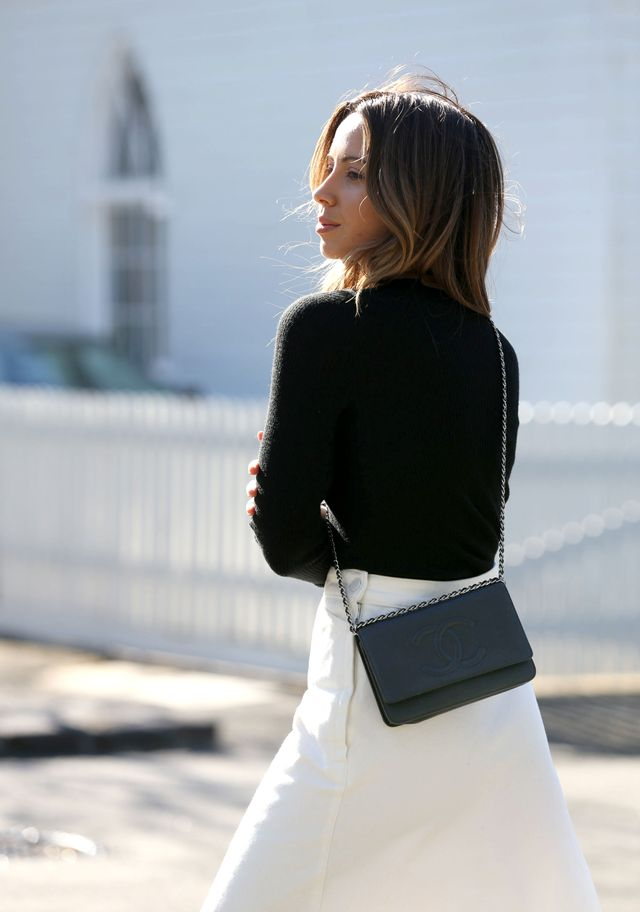 """Monochrome and Chanel, is there a better match? We'd wear this look on days we have to impress. Nothing says """"I mean business"""" more than a structured skirt and simple knit."""