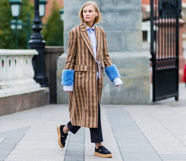 Style Notes: Opt for an unusual coat to lift your shirt-and–black trouser outfit.