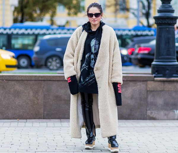 Style Notes: An all-black outfit can seem a little drab, but when you throw a cream-colored teddy bear coat over it, it's totally transformed.