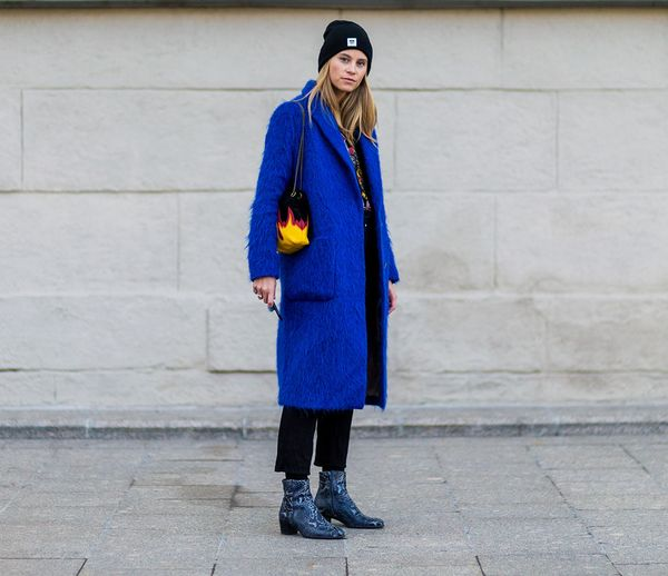 Style Notes: A punchy blue coat and sparkly boots add to the wow factor.