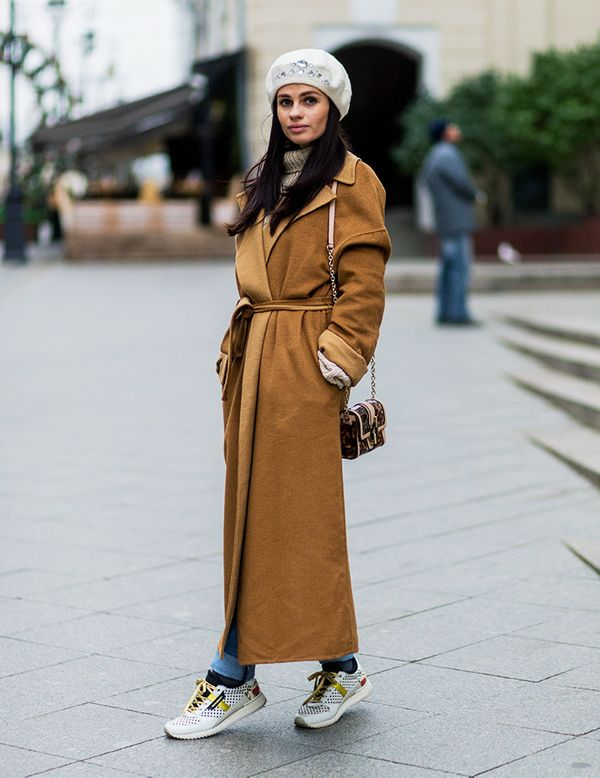 Style Notes: A wrap camel coat is a classic, but paired with trainers, it looks that little bit edgier.