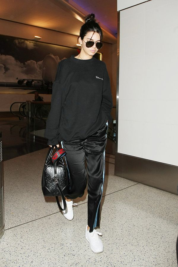 Leave it to Kendall to sport an ideal travel look. On Kendall Jenner: Vetements Oversized Sweatshirt ($750); Nike Air Max Sneakers ($142-$242); Morgan Lane Yana Pants ($288);...