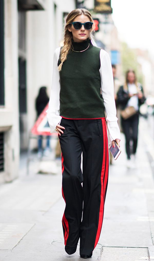 This is how you can pull off track pants for the office if you work in a creative setting—pair them with a blouse and a turtleneck sweater like Olivia. On Olivia Palermo:Rebecca...