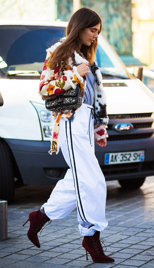 Yes, you can wear track pants with ankle boots—just follow this street style star's lead and tuck them in slightly.