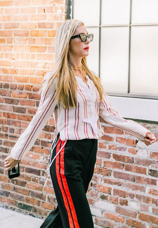 We love how Joanna Hillman tucked in her striped blouse here for a sophisticated feel.