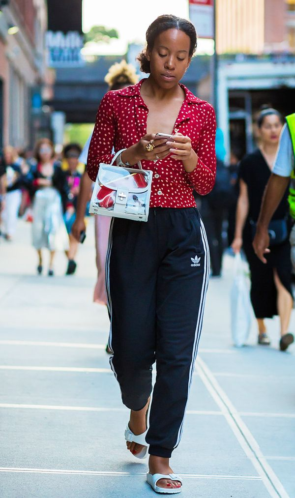For the ideal off-duty look (that totally works for travel as well!), go for a printed top, track pants, and slides.