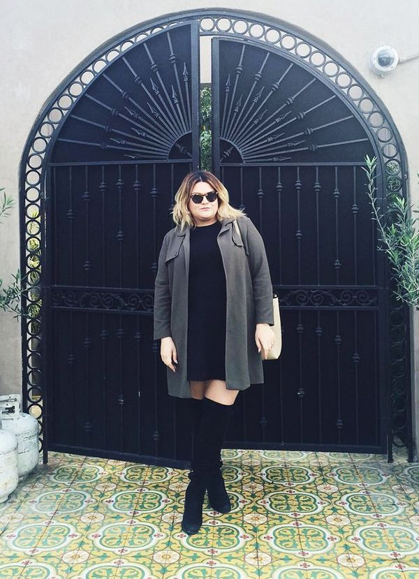 Balance out the proportions of over-the-knee boots with a longer duster and simple T-shirt dress.  On Nicolette Mason: Illesteva sunglasses; Simply Be jacket; Opening Ceremony dress; Stuart...