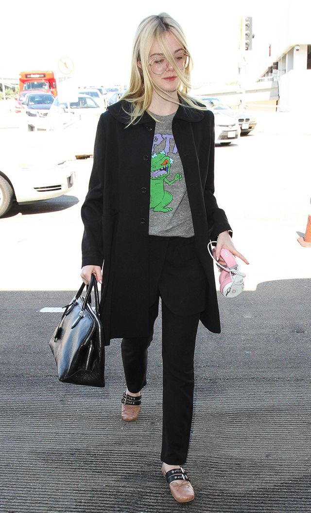 Elle Fanning at LAX in Reptar t-shirt and miu miu flats