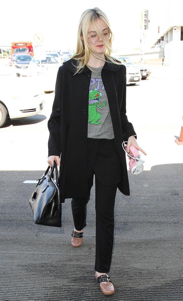 Elle Fanning at LAX in Reptar t-shirt and miu miu flats