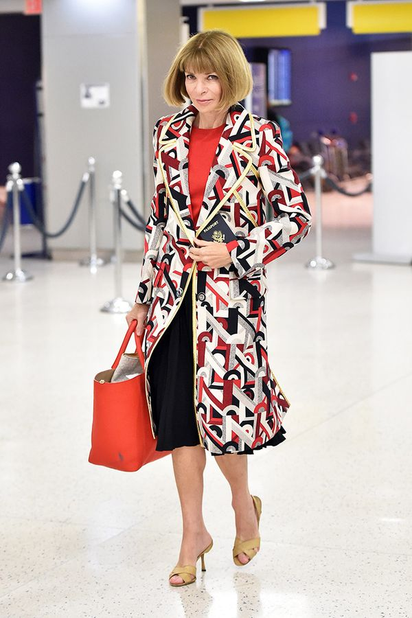 Style Notes: The easiest way to make any outfit you're wearing look even more put together? Add a statement coat (Prada, ideally)like Anna did here.