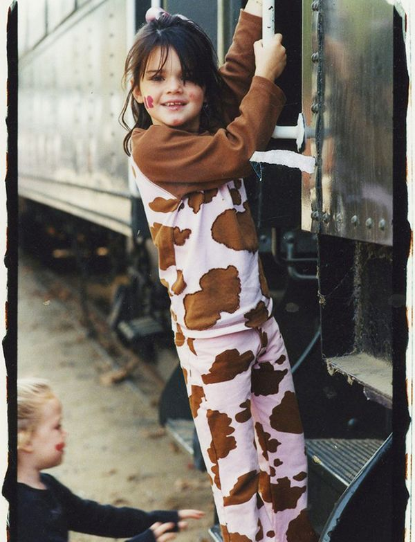 A grade school Jenner looks equal parts cute and comfy as a cow.