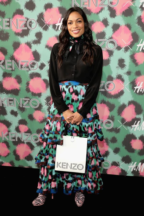 Rosario Dawson wearing Kenzo x H&M top, scarf, skirt, and boots.