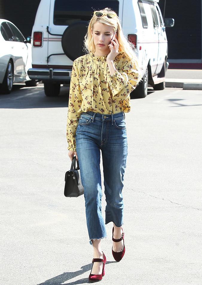 Emma Roberts wearing a yellow Aritzia blouse.