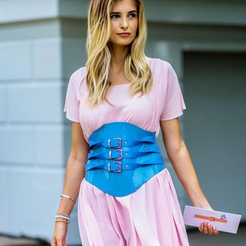 Xenia van der Woodsen in a pink dress and blue belt
