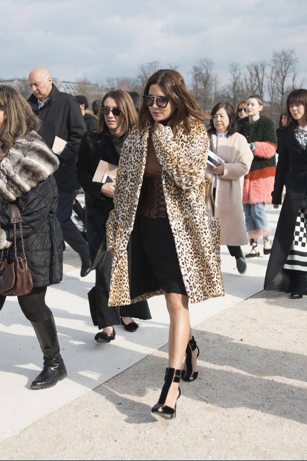 Christine Centenera in a leopard print coat, black pencil skirt, corset belt