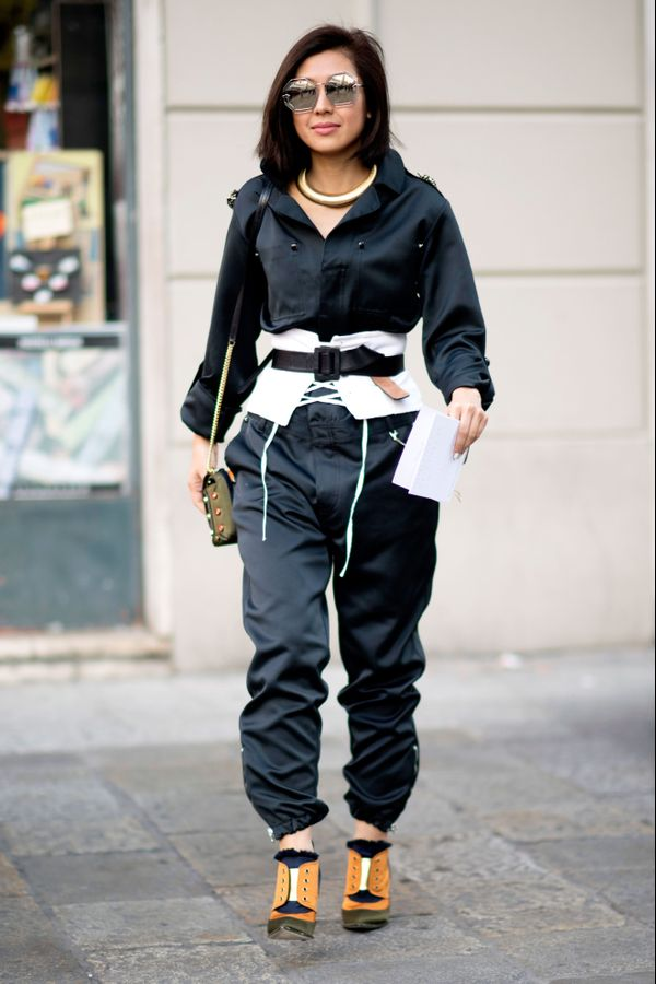 Street style image of a girl in a utility suit and white corset belt