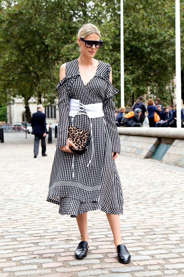 Sofie Valkiers in a gingham Preen dress, white corset belt and leopard print bag.